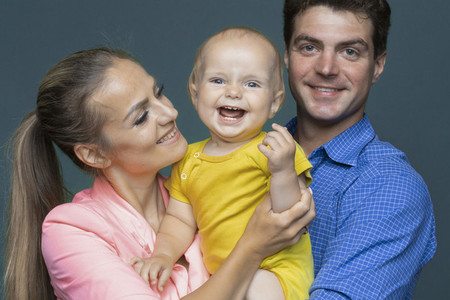 Portrait happy baby boy and parents