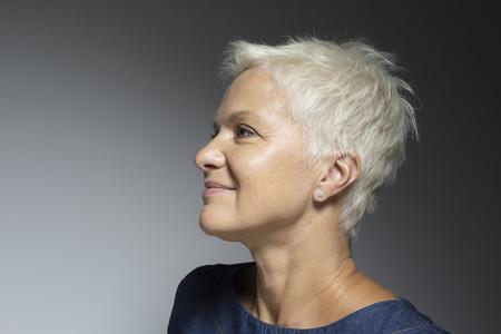 Profile portrait beautiful mature woman with short white hair