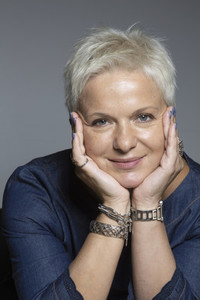 Portrait smiling woman with short hair and bracelets