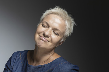 Portrait carefree mature woman with eyes closed