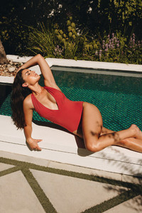 Glamorous woman getting a tan
