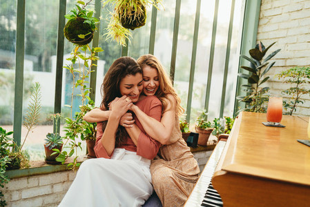 Best friends bonding by the piano