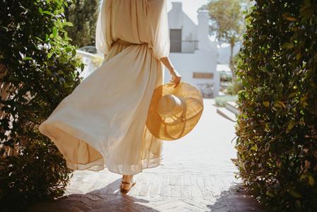 Anonymous tourist woman vacationing alone