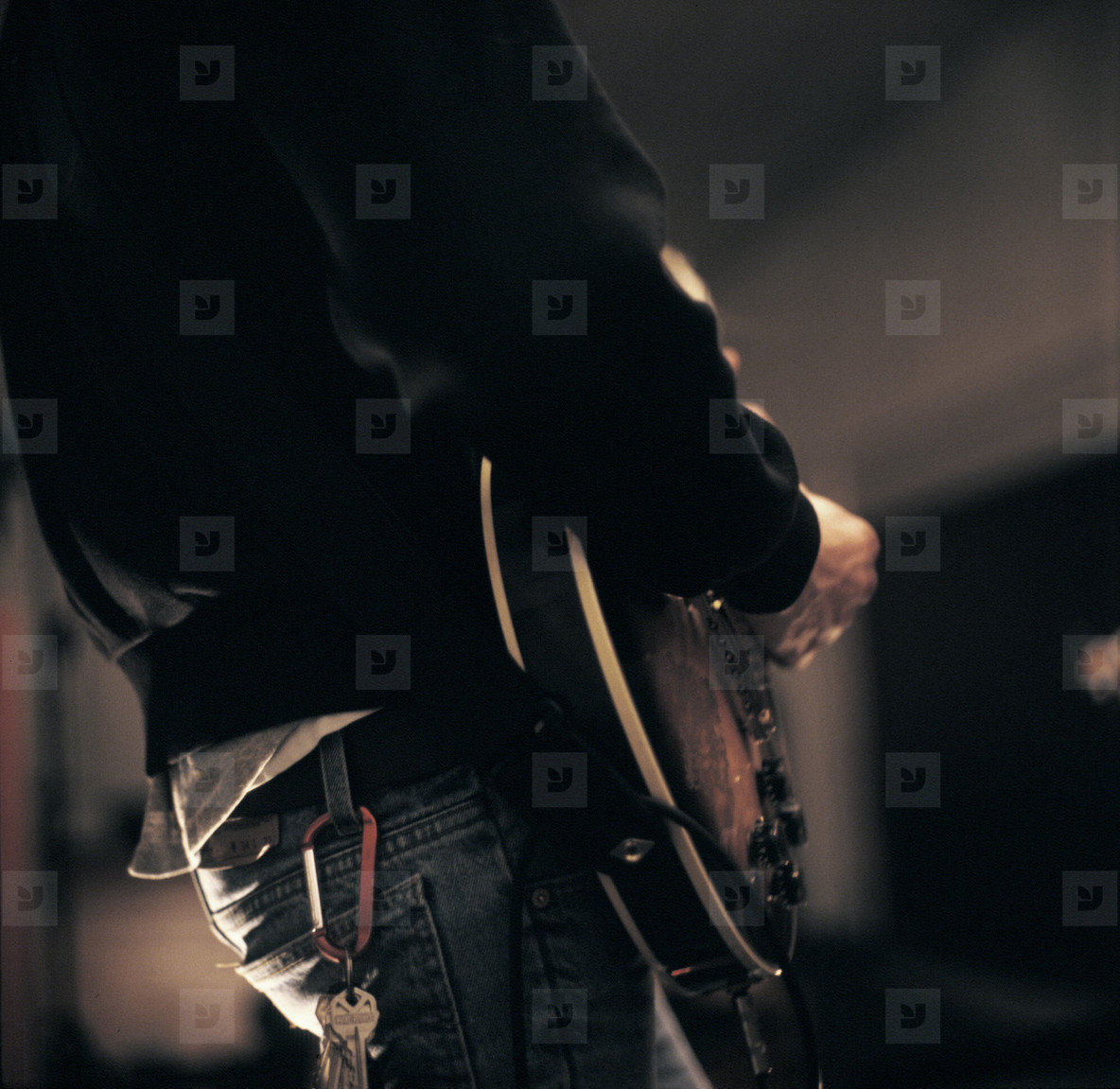 Man practicing guitar