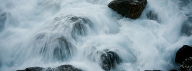 Rushing water flowing over rocks
