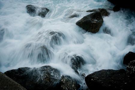 Rushing water flowing over rocks