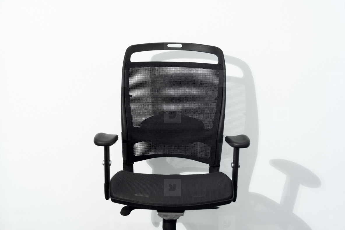 Office chair and white wall