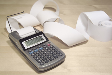 Calculator and paper tape