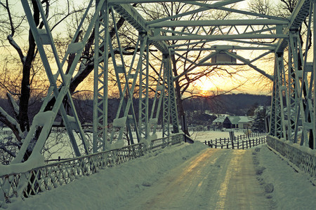 Snow bridge at sunset