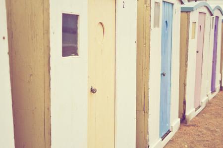 sun bleached beach huts