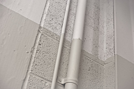 Pipes Attached To Concrete