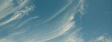 Blue sky with stratus clouds