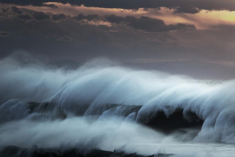 Setting Sun Rising Waves