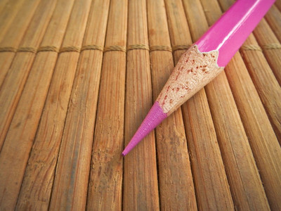 Pencil on bamboo pad background