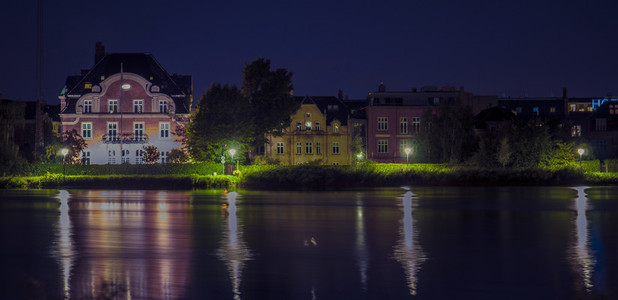 House by the lake at night