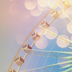Ferris wheel with abstract bokeh