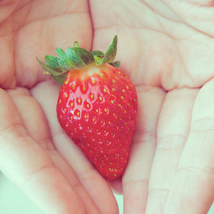 strawberry in hands