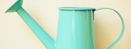 Blue retro watering can