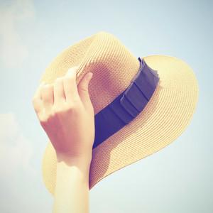 Woman hand holding panama hat