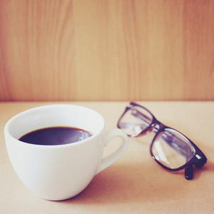 Hot coffee and eyeglasses