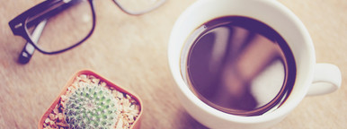 Hot coffee and eyeglasses