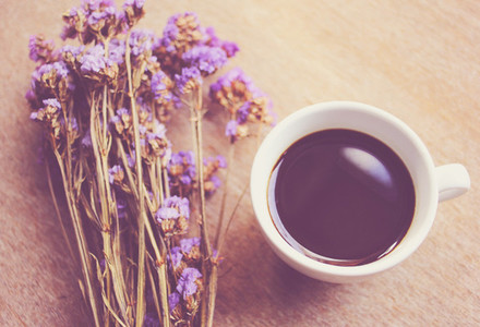 Hot coffee and statice flowers