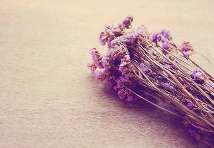 Statice flowers on wooden backgr