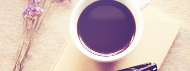 Black coffee on notebook