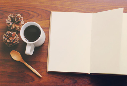 Blank notebook and coffee