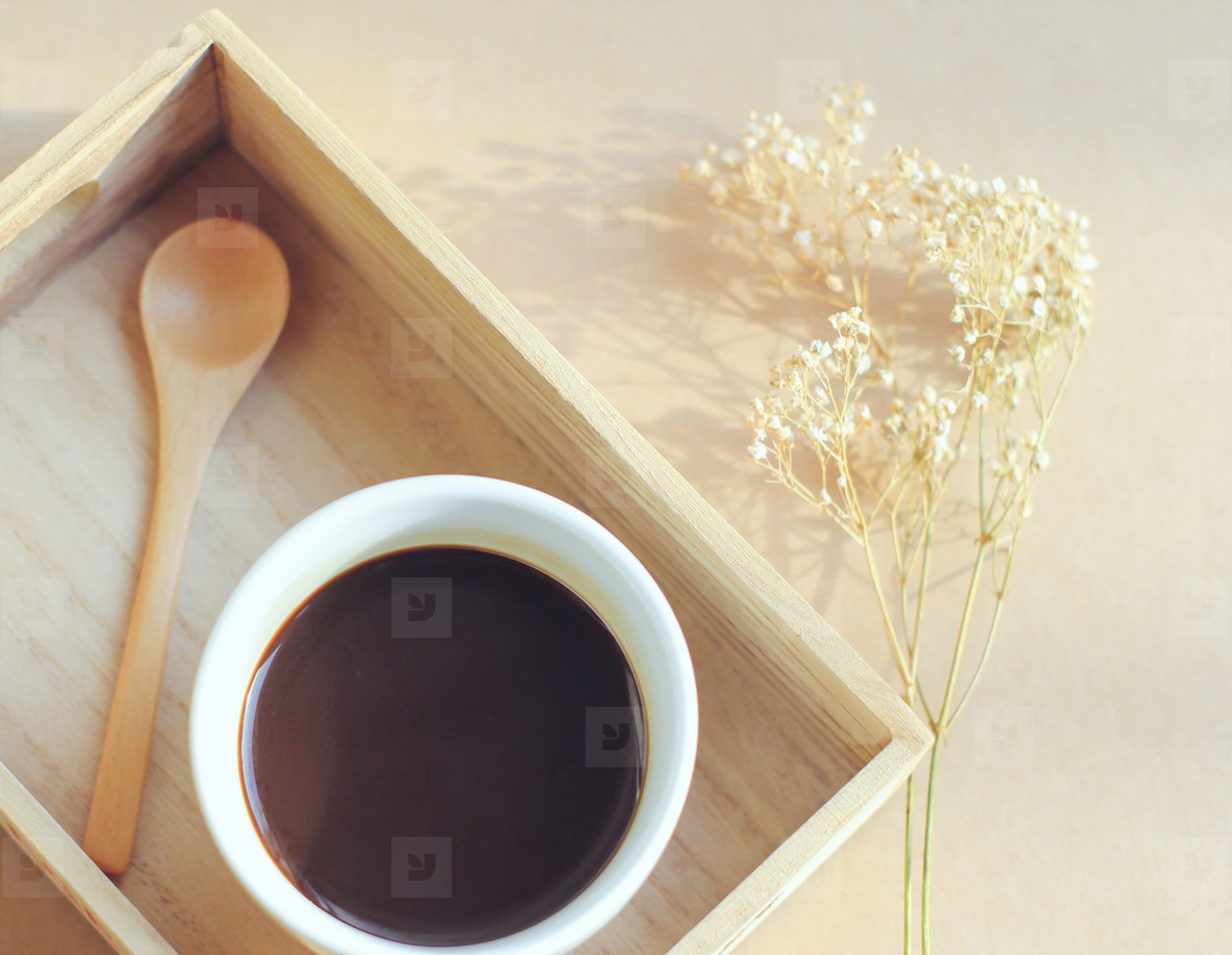 Black coffee and spoon on tray