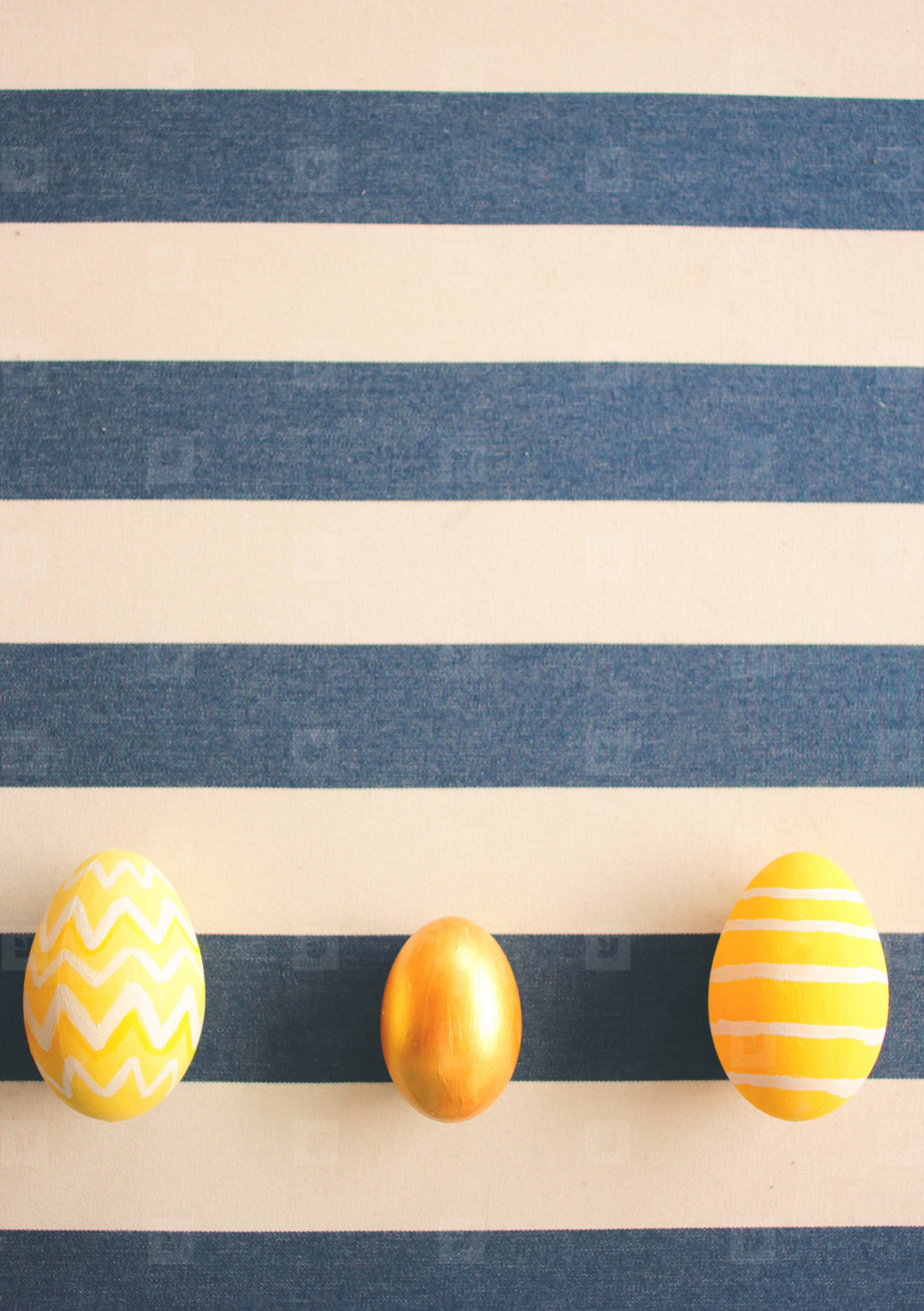 Yellow easter eggs on striped