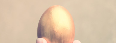 Hand holding painted easter egg