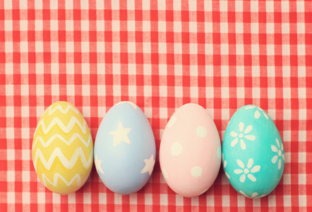 Colorful easter eggs on tableclo