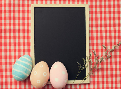 Easter eggs on blackboard