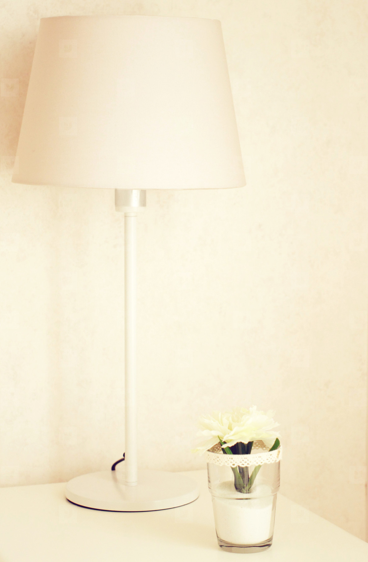 Lamp and flower on the table