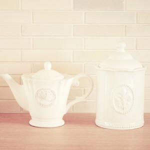 Classic porcelain teapot and jar