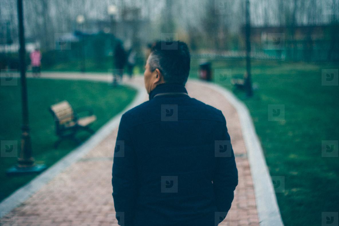 Man Walking on Path