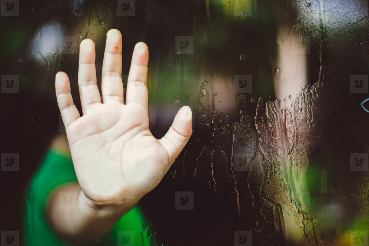 Childs Hand on Glass