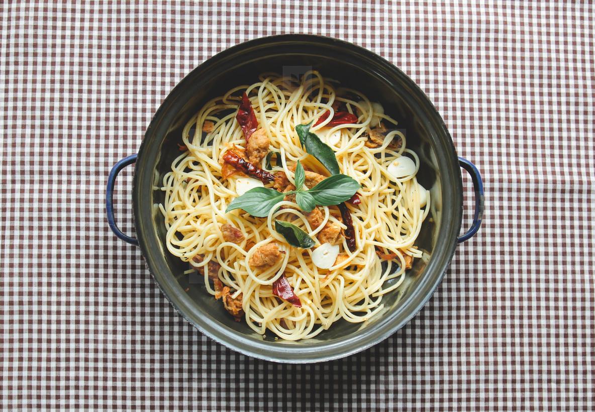 Homemade spaghetti on tablecloth