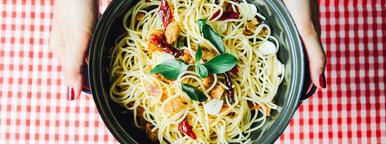Hand holding homemade spaghetti
