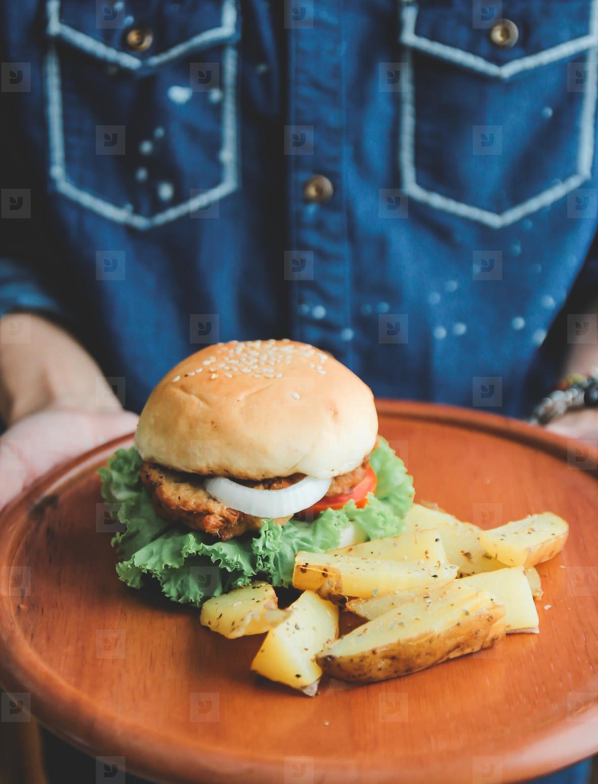 Man holding tasty burger