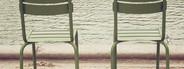 Chairs beside lake