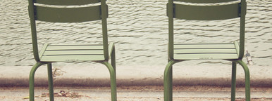 Chairs beside lake