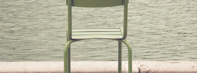 Chair beside lake