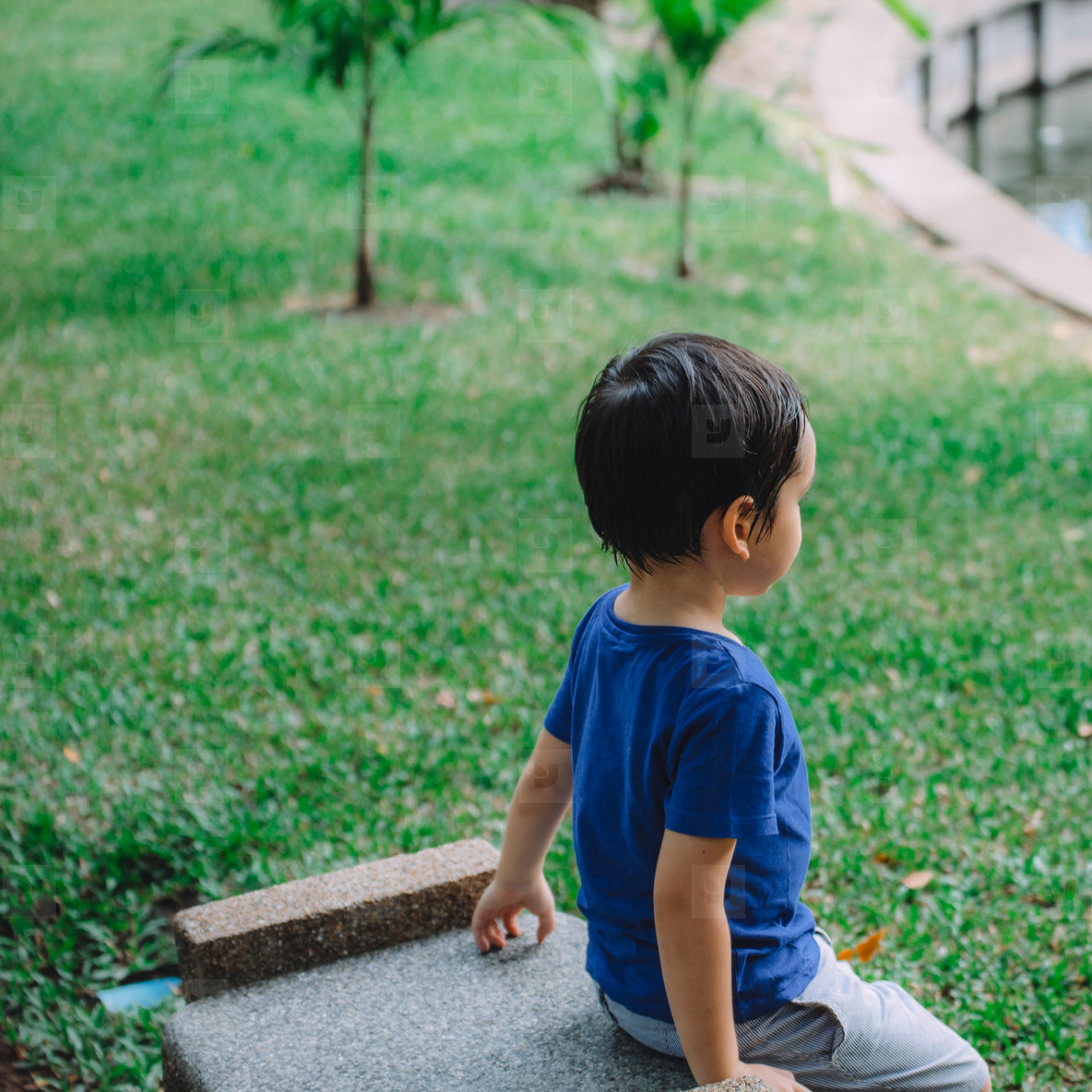 Boy Sitting in Park