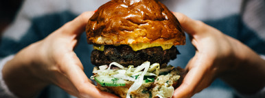 Beef burger in girl s hands