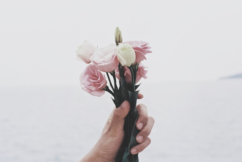 Closeup of Hand holding flowers
