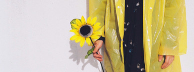 Young woman in yellow rain coat