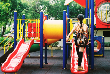 Asian girl at park playground