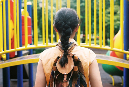 Young girl in back at playground